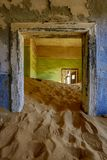 Sand has invaded and taken over these rooms in Kolmanskoppe. Namibia royalty free stock photo