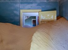 Sand has invaded and taken over these rooms in Kolmanskoppe. Ibia royalty free stock photos