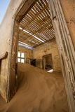 Sand has invaded and taken over these rooms in Kolmanskoppe. Namibia stock photo
