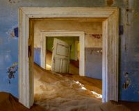Sand has invaded and taken over these rooms in Kolmanskoppe. Namibia royalty free stock images