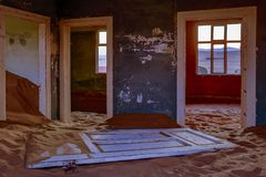 Sand has invaded and taken over these rooms in Kolmanskoppe. Namibia royalty free stock photography