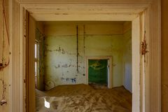 Sand has invaded and taken over these rooms in Kolmanskoppe. Namibia stock images