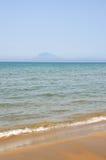 Sand, hav och himmel arkivbild