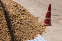 Sand heap for construction and red funnel traffic. Sand heap for construction and red funnel traffic construction site work Stock Image