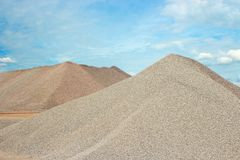 Sand heaps. And blue sky in gravel quarry construction Stock Images