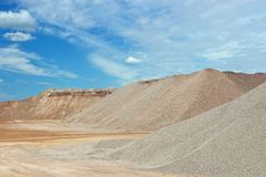 Sand heaps. With blue sky in gravel quarry construction Royalty Free Stock Images