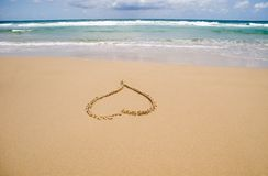 Sand heart. A drawing of a heart in the sand at the beach Stock Images