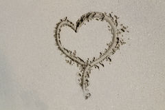 Sand Heart. A heart drawn in the sand on a beach Stock Images
