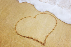 Sand heart Stock Images