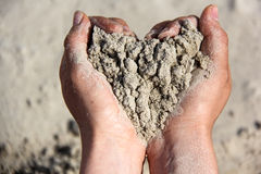 Sand heart in hands Royalty Free Stock Photography