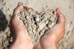 Sand heart in hands Royalty Free Stock Image