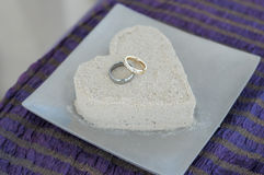 Sand heart and rings Stock Photo