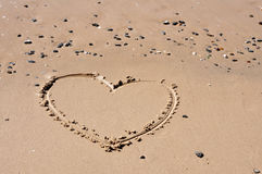 Sand heart. A heart shape drawn in the sand Stock Photography