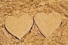 Sand hearts royalty free stock photography