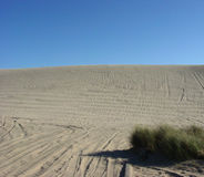 The Sand Hill. A hill of sand under a clear blue sky Royalty Free Stock Photo