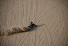 Sand hill race. Motorcycle on sand hill with high speed Royalty Free Stock Photo