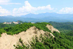Sand Hills Landscape. Landscape with sand hills covered with green plants and mountains in the background Stock Photo