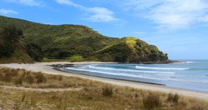 Unspoiled beach landscape in Northland, New Zealand. The sand and hills of Tapotupotu Bay, in the scenic far north of New Zealand Royalty Free Stock Photo