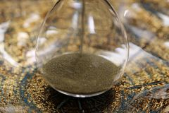 Sand in an hourglass front cover for magazine- bottom of hourglass. Luxury hourglass used as a magazine cover or billboard. The fancy hour glass can represent stock photography