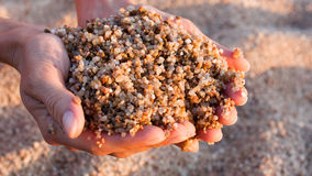 Sand in human hands royalty free stock image