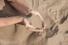 Sand In Hands Stock Photography