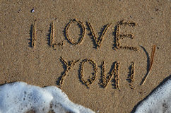 Sand inscription Stock Photos