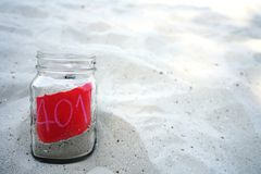 Sand jar on the beach for savings and investment IRA 401k retirement. Retirement concept royalty free stock photo