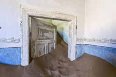 Sand keep the door open. Kolmanskop, Namibia royalty free stock image