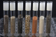 Sand in laboratory testing tubes Royalty Free Stock Photo