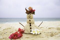Sand Lady standing on beach in Zanzibar Stock Image