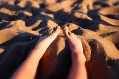 Sand and legs Stock Photo