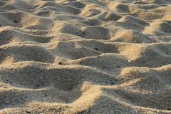 Sand with light in the evening. Sand and sun on the beach Royalty Free Stock Images