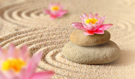 Sand, lily and spa stones in zen garden. Sand, flower lily and spa stones in zen garden. Spa concept Royalty Free Stock Photos