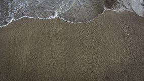 Sand and little waves forming beautiful texture on the beach royalty free stock image