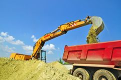 Sand loading in a dump-body truck Stock Images