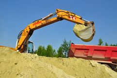 Sand loading in a dump-body truck Royalty Free Stock Photo