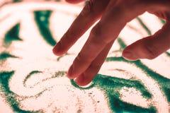 Sand-Malerei Stockfoto