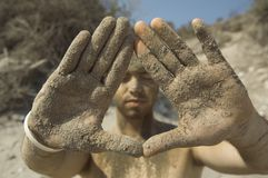 Sand man. Man covered in sand eyes closed Stock Photos