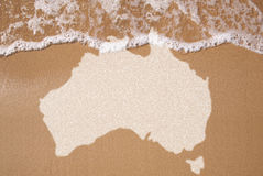 Sand with map of Australian continent. Australian textured map in wet sand royalty free stock images