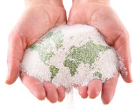 Sand with map of the world in the hands. Isolated on a white background stock photo