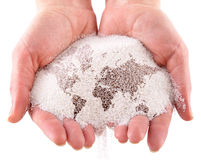 Sand with map of the world in the hands. Isolated on a white background Royalty Free Stock Image