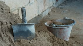 Sand materail and hand tool bucket. In construction site stock photography