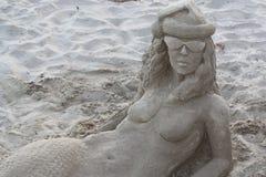 Sand Mermaid. Lying on the beach Royalty Free Stock Image