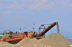 Sand mining. A picture of sand mining activity in progress Royalty Free Stock Images