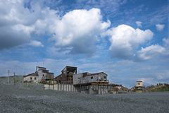 Sand mining. Old abandoned crushed stone production of a sunny summer day Royalty Free Stock Image