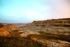 Sand mining quarry in Ukraine. Deep plumage. sunset in the fog over the quarry royalty free stock photos