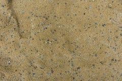 Sand mit kleinen Steinen Stockfotos
