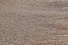 Sand mit Wasserhintermustern Stockbilder