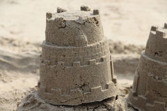 Sand modeling. Holiday concept.  Castle tower. Beach sand toy, kids summer toys, Holiday concept, Sand background, Outdoor Play, close up,  fun summer, drawn in Royalty Free Stock Image