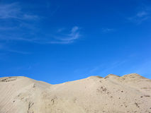 Sand mountain. S in the dark blue sky Royalty Free Stock Photo